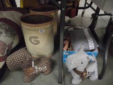 Fabric dog door stops, odd curtain tie backs including some pairs and 2 vintage style paper bins.