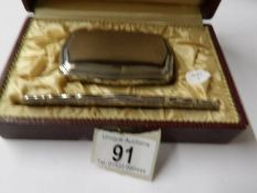 A cased silver backed hair brush and comb.