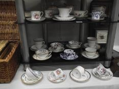 A mixed lot of 19th and 20th century porcelain cups and saucers.