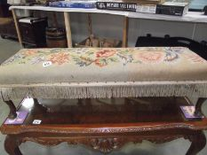 A tapestry covered long foot stool on Queen Anne legs.