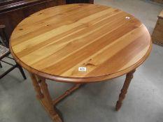 A solid pine gate leg kitchen table.