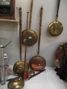 6 brass and copper bed warming pans and a copper post horn.