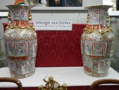 A tall pair of 20th century Chinese vases, 95 cm tall.