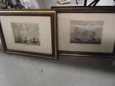 A pair of framed and glazed prints of 19th century Dutch and English fishing fleets.