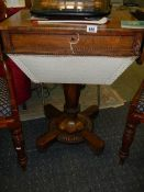 A Victorian figured rosewood sewing table.