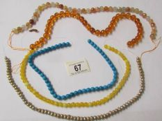 A South American topaz necklace, a stabilized turquoise necklace and 3 others (none have clasps).
