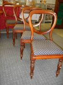 A set of 4 Victorian mahogany balloon back dining chairs.
