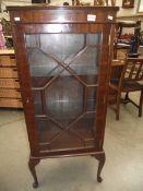An Edwardian mahogany astragal glazed single door display cabinet.