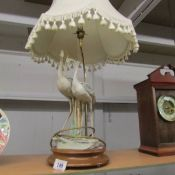A table lamp in the form of a pair of storks complete with shade, Tail on one bird a/f.