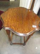 An Edwardian oak side table.