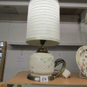 A Belleek table lamp with shade.