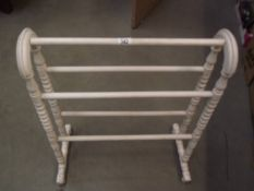 A painted wooden towel rail.