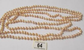 A one hundred inch long genuine pearl necklace.