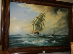 A large oil on canvas seascape depicting sailing ships on rough seas.