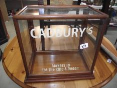 A table top display cabinet with Cadbury advertising.