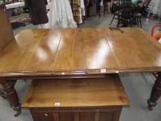 A Victorian mahogany wind out table with 2 leaves.