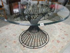 A top quality designer glass top table and 4 matching chairs.