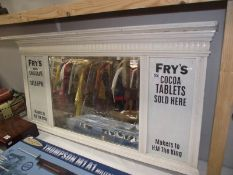 A bevel edge mirror with painted frame and Frys Cocoa advertising to sides.