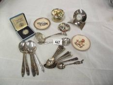 A mixed lot including s/p spoons, Hummel plates, Hummel picture paperweight, German music box,