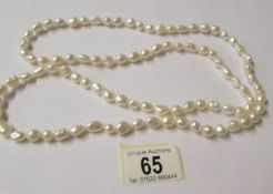 A thirty eight inch long pearl necklace.