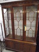 A good inlaid astragal glazed display cabinet with drawers and cupboards by Maples.