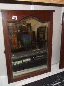 An Edwardian oak bevel edge mirror