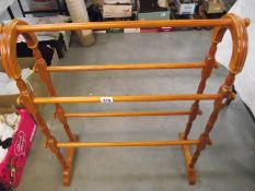 A solid pine towel rail.