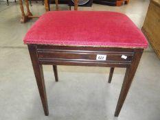 An Edwardian mahogany piano stool with contents.