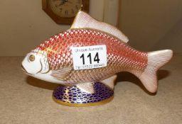 A Royal Crown Derby model of a carp fish.