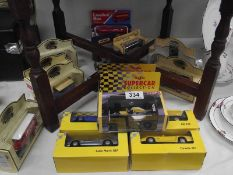 A quantity of various boxed die cast cars.