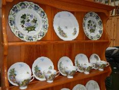 An 18 piece tea set and 2 Booth's plates.