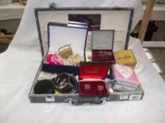 A jewellery case and mixed costume jewellery etc.