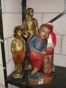 3 1930's painted plaster figures including whistling boy and a painted wooden figure of a golfer