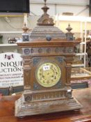 A large Edwardian oak mantle clock i.w.o.