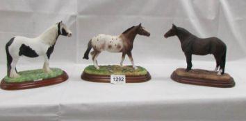 3 stallion figures being Appaloosa, Quarterhorse and coloured.
