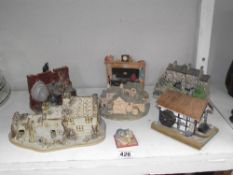 A quantity of pottery and china including cottages, cats.