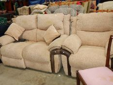 A reclining sofa and matching chair.