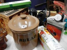 A mixed lot of kitchen ware, bread pot etc.