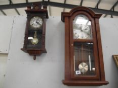 A 31 day wall clock and 1 other