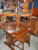 A draw leaf table and 4 chairs.