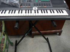A freestanding Yamaha Parta sound keyboard.