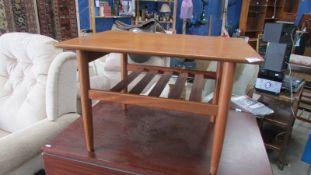 A teak side table.