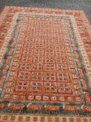 A machine made carpet with men on horses, 300 x 200 cm.