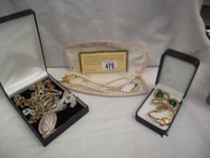 A mixed lot of costume jewellery including pearls etc.
