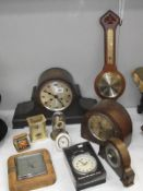 A 1930s oak mantel clock and other closk and barometers