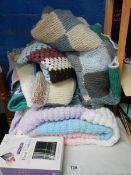 A knitted blanket and other items.