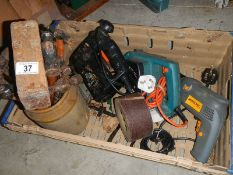 A box of tools, fret saw, planer, drill, hammers etc.