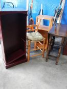 An old gateleg table, a stool, a cabinet and a mahogany bookcase.