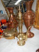 A brass teapot, brass coffee pot and 2 copper pots.