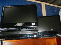2 flat screen television sets and a Panasonic recorder.